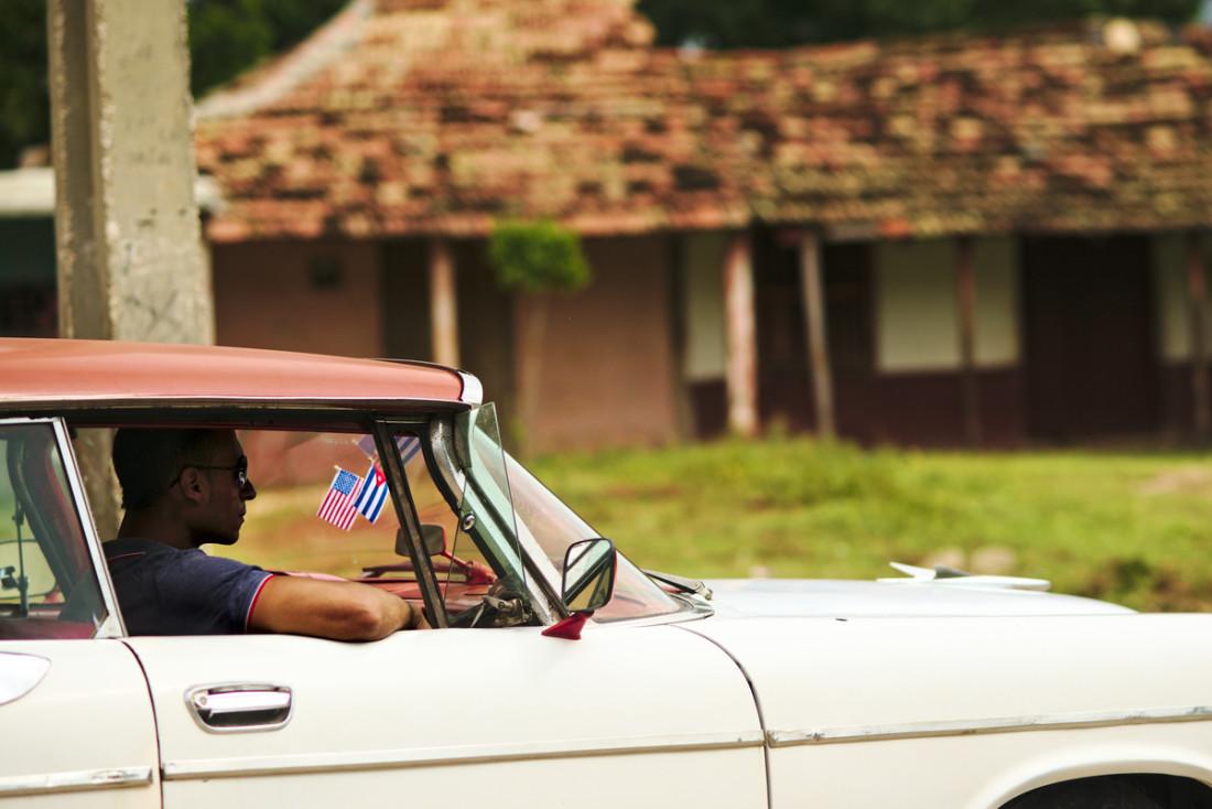 Old American car parked at a backstreet of Trinidad.